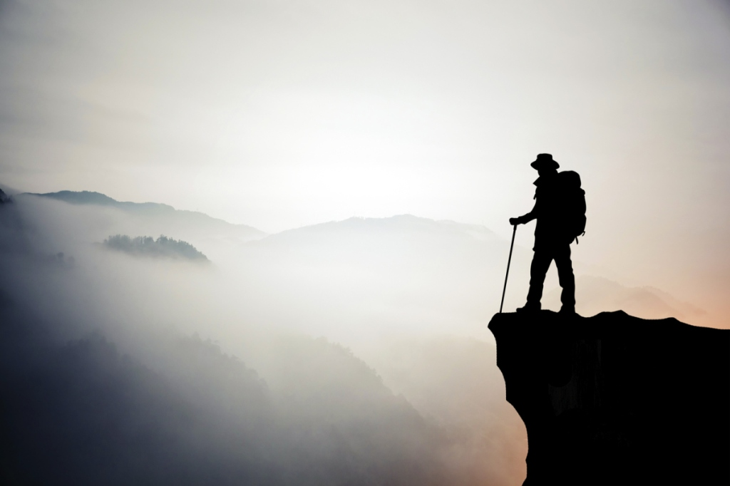 Silhouette of hiking man in mountain